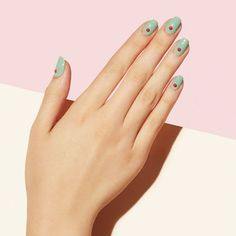 On The Dot - For a girl on the go, adding a dot to each nail in a color that complements your polish is the perfect way to look elevated in no time.