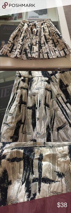 Adele cream/gold/black skater skirt Adele cream/gold/black skater skirt . Metallic accents , front pockets. Adorable. A must have. NWOT Adele Skirts Mini