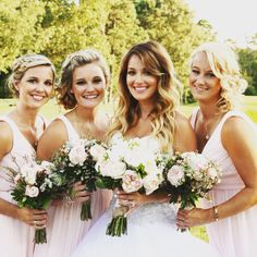 Loved the pink bridesmaid dresses with the flowers. Beautiful bride and great wedding photographer