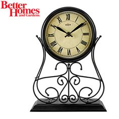 Better Homes & Gardens Wrought Iron Mantel Clock This Better Homes and Gardens® Wrought Iron Mantel Clock will be a lovely addition to your breakfast room, bedroom, family room or sun room.The antiqued color face, Roman numerals and large hands can be seen with ease.Clock features a wrought-iron design and clock face features gold antique and gold crackle background with black hands that match beautifully.Simple lines, classic styling, brown wrought iron with a sturdy base--all features that…