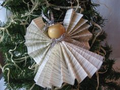 Paper Angel Ornament.  It would be fun to use vintage Christmas carol paper.