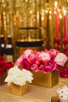 pink centerpieces in gold containers, photo by Sara & Rocky Photography http://ruffledblog.com/gold-and-pink-valentines-day-shoot #weddingideas #weddingcenterpieces #flowers