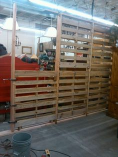 Under construction pallet wall by.  RJ Diaz & CO.