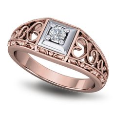 Rose gold diamond ring. This design has an illusion plate setting for the centre diamond