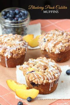 Blueberry Peach Cobbler Muffins - with the best crumble topping! @spoonfulflavor