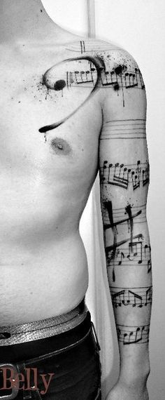 I like that this is an entire sleeve tattoo. Usually I just see music staffs on wrists. The bass clef and sharp sign splashed in there are nicely incorporated, and it really makes the tattoo pop.