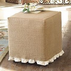burlap ottoman with white ruffle. Burlap ottoman covers edged in lace you could hide the rip in the one you have and bring the primitive deco into your livingrooom! love the burlap slipcover, we have burlap cubes at One Eleven Main! Burlap Ottoman, Burlap Tablecloth, Ottoman Table, Ottoman Slipcover, Tablecloths, Burlap Projects, Burlap Crafts, Chair Covers, Table Covers