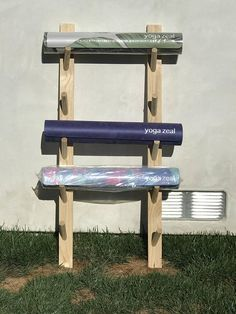 Wooden Yoga Mat Rack Pricing Pine yoga mat rack: - 2 mat rack - $50.00 - 3 mat rack -$65.00 - 4 mat rack - $75.00 - 5 mat rack - $95.00 - 6 mat rack - $95.00 (i.e. two racks that hold 3 mats each) - 10 mat rack $190.00 (i.e. two racks that hold 3 mats each) Dimensions: A yoga mat