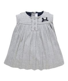 Cozy, cuddly and undeniably adorable, this Italian-designed piece will bundle little ones in quality and comfort with a gathered bodice for plenty of room and a sweet ruffle placket.