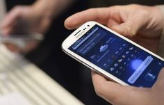 A man uses Samsung's new Galaxy S III smartphone during its launch at The Earls Court Exhibition Centre in London May 3. The phone has a 4.8-inch, 720 HD display and an 8 MP rear-facing camera. It will run on LTE and HSPA+ networks, the company said in a release.