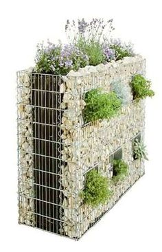 "Here's an idea: Sandwich a layer of soil in-between the rock layers in a Gabion wall. Leave some ""holes"" in the exterior rock layer for plantings. Makes a great living fence."