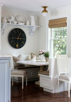 Breakfast nook with large wall clock. The Elegant Abode.