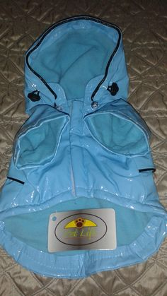 """Pet Life Dog Light Blue Rain Jacket Coat Extra Small - XS Pet Life PVC Baby Blue Fashion Raincoat symbolizes what your trendy pet is all about. One of the most fashionable PVC waterproof Raincoats out there! Perfect for walkers of both sexes. Features light blue fleece. From back of neck to tail area (in inches) - 