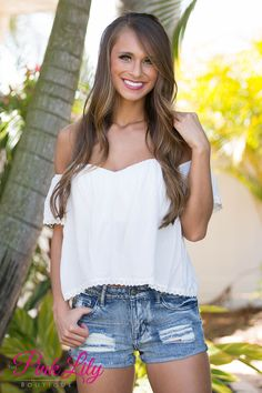 You will be hooked when you see this blouse for the first time! The off the shoulder style and the solid white color makes it the perfect, verstaile top to pair with anything!