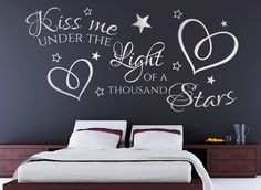 """Kiss me under the light of a thousand stars wall art sticker  This stunning """"Kiss me under the light of a thousand stars"""" decal features lyrics from the Ed Sheeran song 'Thinking Out Loud', which makes a perfect wall art for your bedroom.  Precision cut from high quality matt finished ultra-thin vinyl, look absolutely stunning & appear as though they are painted onto the surface. Variety of colours & sizes…"""