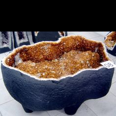 A large citrine geode coffee table. Www.cathedralgeodes.com