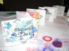 Elements of Art book - this would be a nice idea for a final exam of art skills. Each element would demonstrate a different skill, art style and medium while still maintaining unity and rhythm.