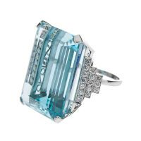 90ct Aquamarine, Diamond & Platinum Ring.The thirty diamonds weighing 1.20 carats perfectly frames the center stone, providing a lovely accent without distracting from the Aquamarine's inherent bold beauty.