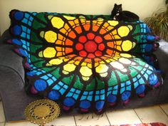 http://thetwistedyarn.com/2014/03/25/crochet-stained-glass-window-rainbow-afghan-finished/