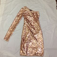 """BCBG """"Lyn"""" copper sequined dress This is a stunning showstopping BCBG sequined dress in copper. Size XXS.  Perfect for prom or night out on the town. Please let me know if you have any questions. BCBGMaxAzria Dresses One Shoulder"""