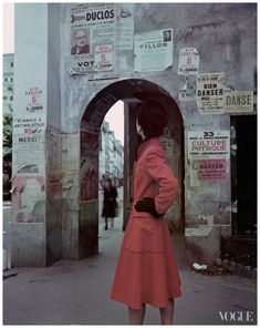 Model in Paris wearing a red coat with oversize pockets by Molyneux,    Photographed by John Rawlings, Vogue, March 1946