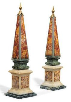 A PAIR OF ITALIAN VARIEGATED MARBLE OBELISKS LATE 19TH CENTURY - The marbles including grey Saint Anne, pink and yellow brocatello, verde antico and red jasper, headed by gilt-metal finials, 23,5 in. (59.5 cm.) high