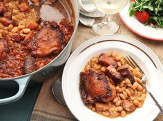 Traditional French Cassoulet. Serve with rustic bread and simple green salad, citrus vinaigrette. Tarte tartan for dessert. Red wine (tannin).
