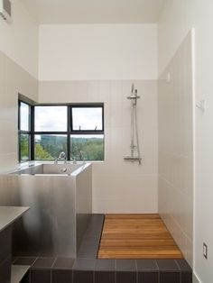 Maybe a little too minimal, but like the soaking tub (pictured tub is extremely pricey, but might be able to do a drop-in) and wood floor covering the drain for the shower