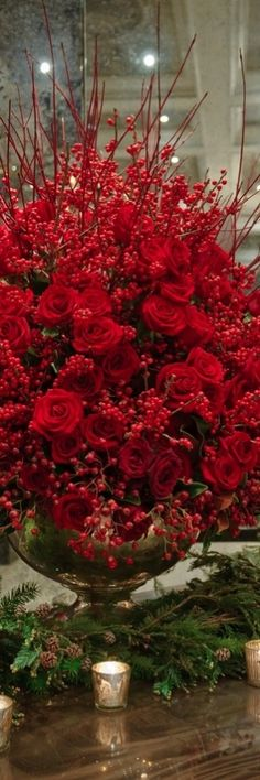 Red roses and pine make a glamour girl's home look so marvelous for the Christmas holiday....