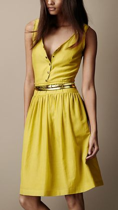 Elegant sleeveless dress in textured silk  Fitted waist panel and full gathered skirt accentuate the feminine silhouette