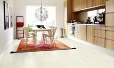 white pergo floor with wood tone cabinets