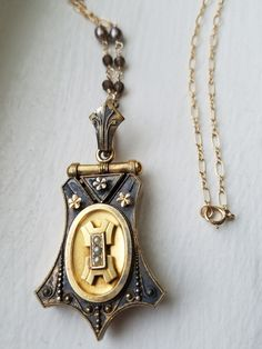 If you are looking for something old and something special, this is a perfect piece for you! This Victorian period call back to the ancient Egyptians, is very old (over 100 years old) and very gorgeous. The antique bell shaped gold-filled locket exhibits intricate metal work and is accented with seed pearls on the front. Opening from the back, it reveals one compartment to store your photo, a lock of hair, or a love note! So precious! I added a handmade gold filled chain (27.5 inches in…