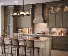 Kitchen Photos: 18 Kitchens You're Going to Love.. I kind of love this color with the brick backsplash.
