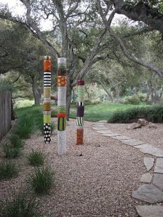 "painted posts...photo by Sean A. O'Hara  I think these are ceramic ""beads""....clay, painted and fired for permanency.  Correction please, if I'm wrong."