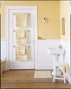 An excellent idea for my bathroom, since I have almost zero wall space: towel bars attached to the door! (Except where would I hang my bathrobe, then? Hmm….)