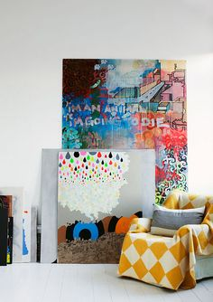 Large artwork and harlequin draped chair.