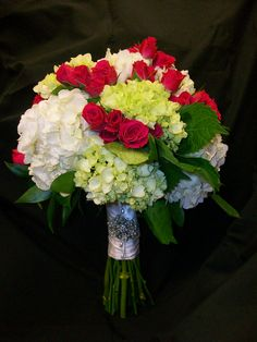 Brides bouquet of white and green hydrangea with fushia spray roses