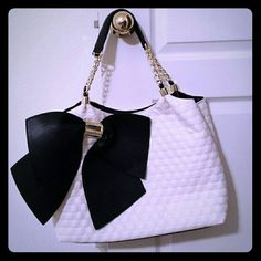 Betsey Johnson Bowlicious Tote Purse In bone and black with a pretty interior, this tote is fun! With a gold chain in the straps and gold accents. So new, the metal bits are still covered in plastic. Betsey Johnson Bags Totes