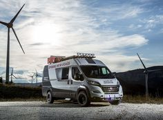 the fiat ducato camper van sports a two-tone paint finish, and comes outfitted with an LED light bar, a front winch, and a lot of capacity for carrying cargo on the roof.