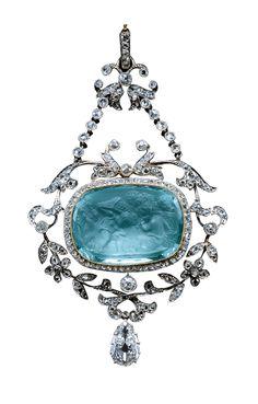 Aquamarine cameo pendant, circa 1905, composed of platinum, gold, diamond and aquamarine.