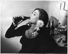 Flamenco dancer ''La Chunga'' having a Coke break in the dressing room.