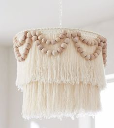A little bit beachy, a little bit boho-chic, this handmade chandelier has tiers of cotton fringe accented with garlands of wooden beads. Capiz Chandelier, Handmade Chandelier, Chandeliers, Nursery Chandelier, Chandelier Ideas, Chandelier Lighting, Chandelier Shades, Deco Bobo, Idee Diy
