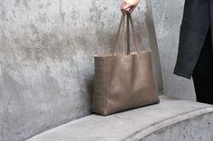 Moto inspired tote handcrafted in our San Francisco studio made from full-grain leather. Lightweight and comfortable, this roomy tote fits all your goodies including your laptop. San Francisco Woman, Local Women, Neutral Colors, Women's Accessories, Monogram, Purses, My Style, Leather, Stuff To Buy