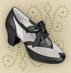 I have these, and I LOVE them!! Aris Allen Black & White 1940s Peep-toe Heeled Mesh Oxford