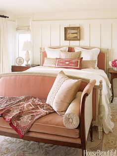 11 ways to maximize a small space. bigger — but fewer — furnishings It may seem counterintuitive, but outfitting a small space with just a few large-scale pieces (rather than a mishmash of pint-size furniture) can actually make it feel grander. Pink Settee, Home Bedroom, Bedroom Decor, Master Bedroom, Bedroom Couch, Bed Room, Master Bath, Pink Headboard, Blush Bedroom