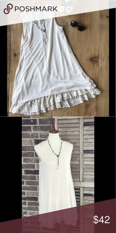 Sleeveless Dress With Lace Detail This cream sleeveless dress is lined and has a lace trim hem. It has a flowing and forgiving fit! Umgee Dresses High Low