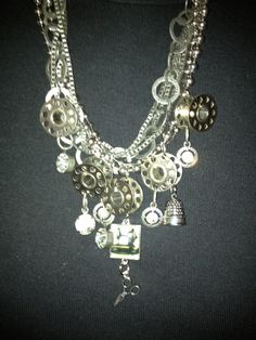 Sewing bobbins made into a necklace -- for mom!