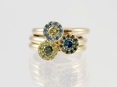 Colored diamonds in 18kt gold handmade staking rings. Union Street Goldsmith, San Francisco