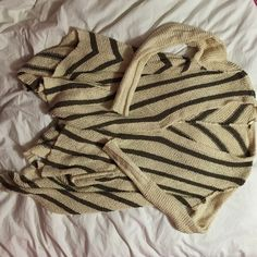 Free People Striped Shark Hem Cardi Free People shark hem cardi. Super comfy, chunky cardigan. Color is ivory with brown stripes. Size SMALL. This can definitely fit size XS-M in my opinion! Love this piece but I sadly just don't wear it enough! Free People Sweaters Cardigans