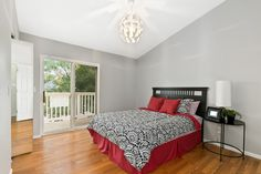 Upstairs bedroom with direct access to the private balconies perfect for relaxing or drinking your morning coffee.